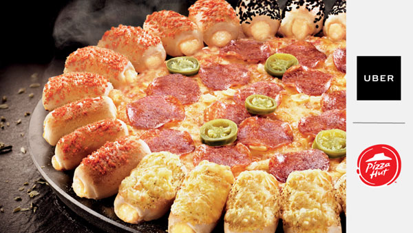 În perioada sărbătorilor, Pizza Hut și Uber îi răsplătesc pe cei care înfruntă aglomerația de sezon