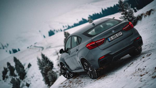 Iarnă extremă şi drumuri îngheţate de munte – cu BMW X6 în căutarea filmării perfecte