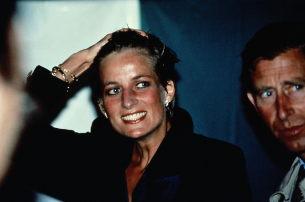Picture shows_Princess Diana with wet hair at a Pavarotti concert in Hyde Park, London, 30th July 1991