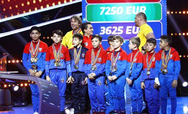 Florin Răducioiu, Cătălin Moroșanu și Marian Drăgulescu au câștigat 7.250 de euro, pentru viitorii mari campioni la gimnastică ai României
