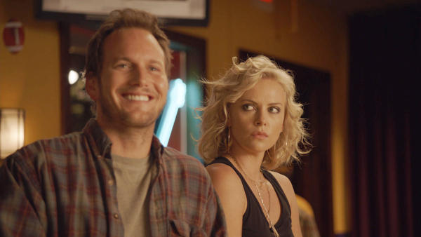 Left to right: Patrick Wilson plays Buddy Slade and Charlize Theron plays Mavis Gary in YOUNG ADULT, from Paramount Pictures and Mandate Pictures.