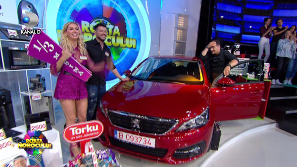 Victor Slav si Andreea Banica au castigat masina la Roata Norocului
