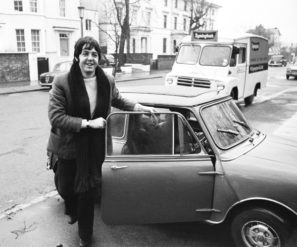 Paul McCartney -The Beatles - with his Mini, 1967. Photo by WilsonMirrorpixMirrorpix via Getty Images