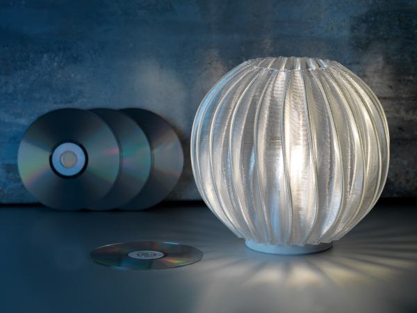 Philips LED table lamp printed from recycled CDs, credit Signify