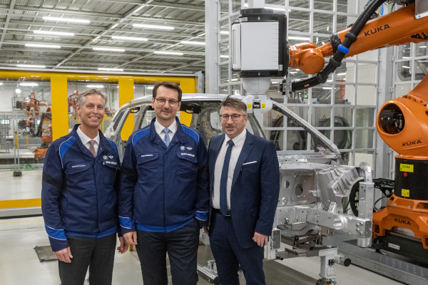 BMW Group Plant Dingolfings Director Christoph Schroder, Member of the Board of Management of BMW AG, Production, Dr. Milan Nedeljkovic, and Head of the Works Council of BMW Group Plant Dingolfing, Stefan Schmid, are visiting the construction of the BMW iNEXT body shop