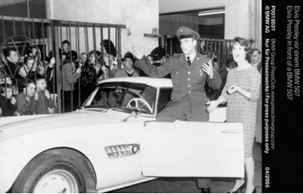 Elvis Presley in front of a BMW 507