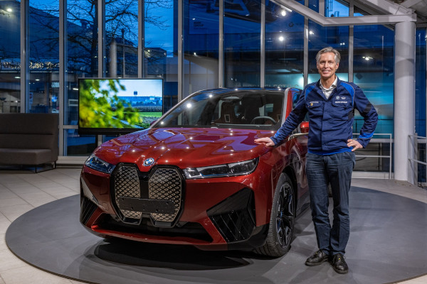 Christoph Schröder, Head of BMW Group Plant Dingolfing, showing the BMW iX