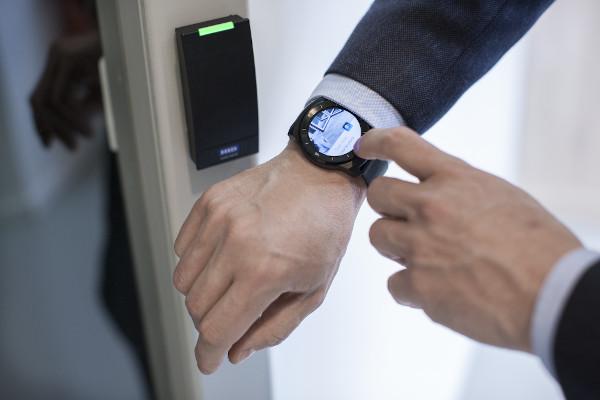 Man using smartwatch to open door